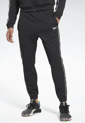 WORKOUT READY PANTS - Pantalones deportivos - black