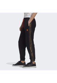 adidas Originals - CAMO JOGGERS - Tracksuit bottoms - black - 2