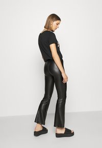 ONLY - ONLCOOL FLARED - Trousers - black - 2