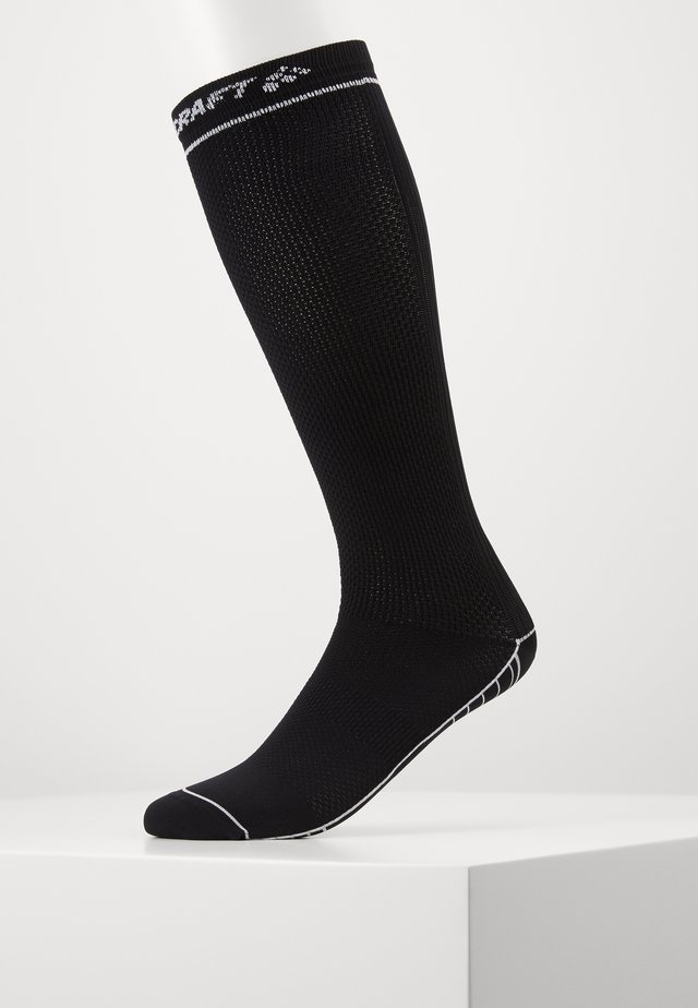 COMPRESSION SOCK - Sports socks - black/white
