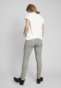 ECHTE - Trousers - black - 2