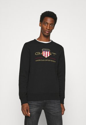 ARCHIVE SHIELD  - Collegepaita - black