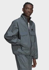 adidas Originals - FASHION TT - Training jacket - blue - 3