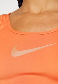 Nike Performance - BRA - Medium support sports bra - light sienna/healing orange - 3