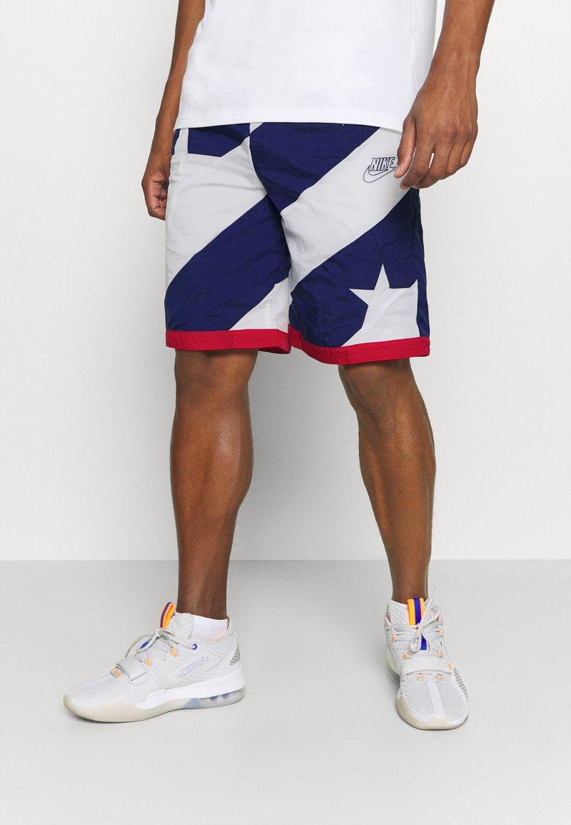 Nike Performance - THROWBACK - Sports shorts - blue void/white/university red
