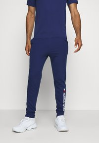 Tommy Hilfiger - CUFF PANT LOGO - Tracksuit bottoms - blue - 0