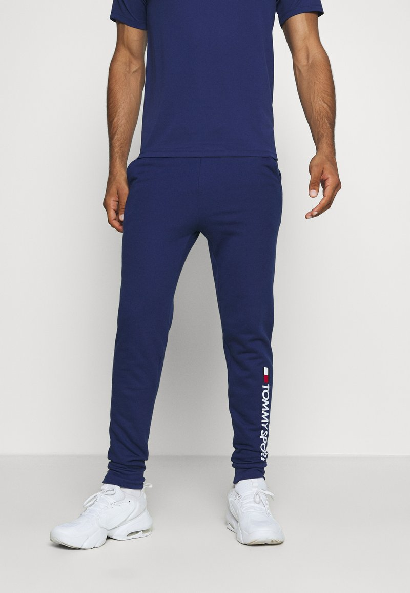 Tommy Hilfiger - CUFF PANT LOGO - Tracksuit bottoms - blue