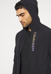 Calvin Klein Performance - PRIDE WINDJACKET - Training jacket - black - 3