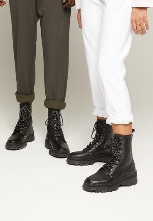 TESFA BOOTS UNISEX - Enkellaarsjes met plateauzool - black