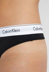 Calvin Klein Underwear - MODERN PLUS THONG - Thong - black - 4