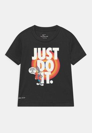 HEMTAPE TEE UNISEX - Print T-shirt - black