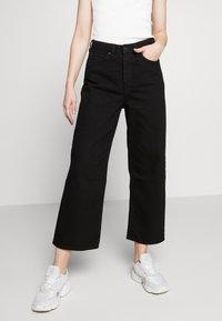 Monki - Relaxed fit jeans - black dark - 0