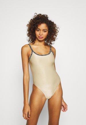 CORE FESTIVE SCOOP ONE PIECE - Swimsuit - gold-coloured