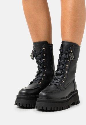 GROOVY CHUNKS - Platform ankle boots - black