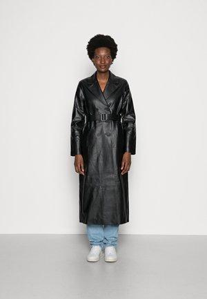 LIONNE - Classic coat - black