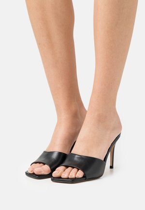 MOGUL - Heeled mules - black