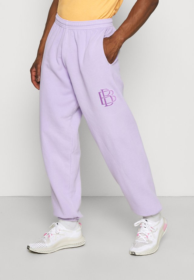 OVERDYE EMBROIDED JOGGER UNISEX - Tracksuit bottoms - lilac