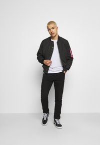 Alpha Industries - PARACHUTE - Bomber Jacket - black - 1