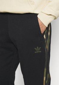 adidas Originals - CAMO  - Tracksuit bottoms - black/wild pine/multicolor - 3