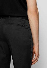 BOSS - KAITO - Pantaloni eleganti - black - 3