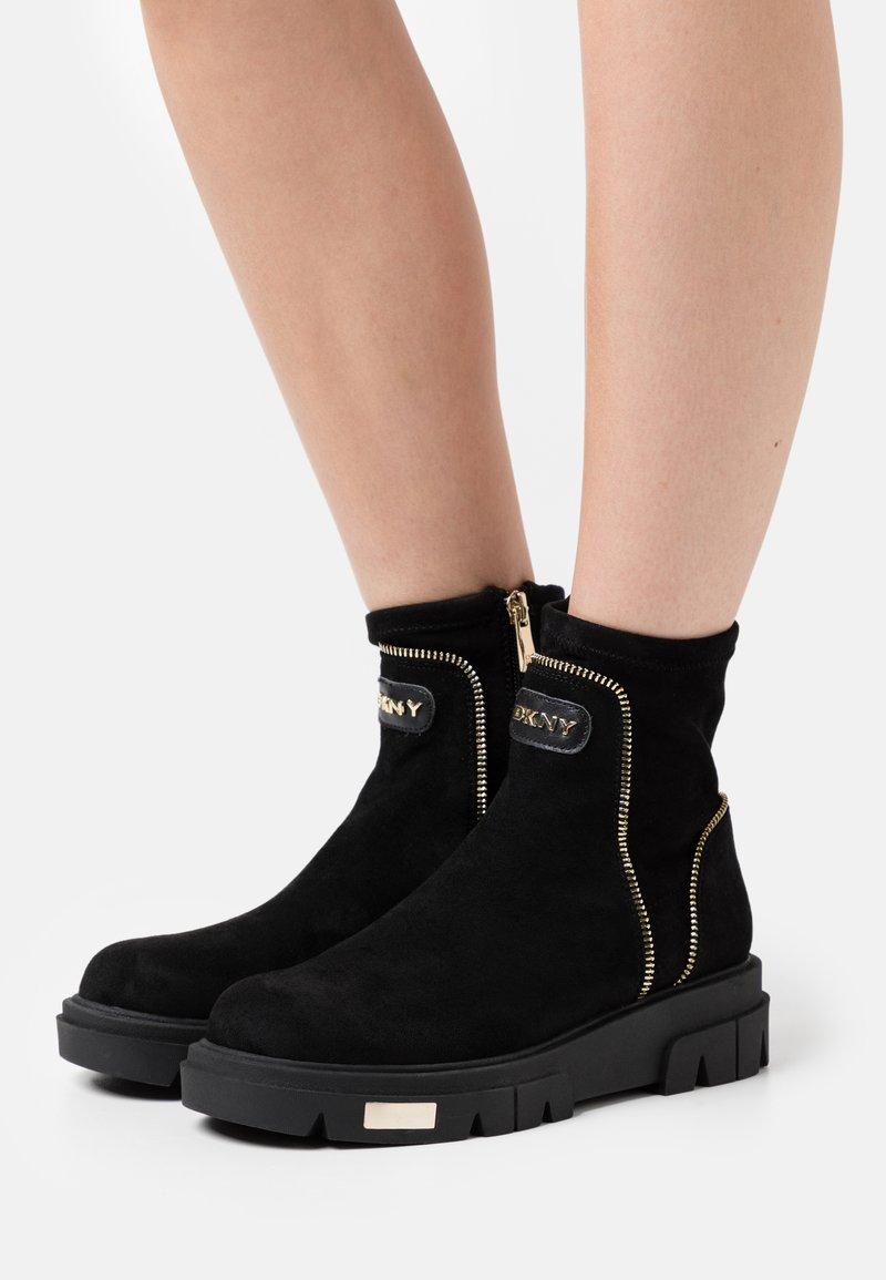 DKNY - LIZZI  - Platform ankle boots - black