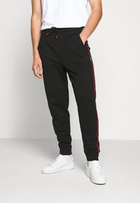 HUGO - DOAKY - Tracksuit bottoms - black - 0