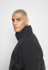 adidas Originals - REGEN PUFF - Down jacket - black - 3
