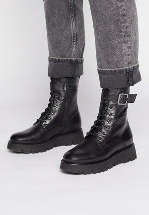 CLEO - Platform ankle boots - black