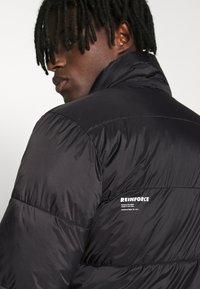 Redefined Rebel - PUFFER JACKET - Winter jacket - black solid - 5