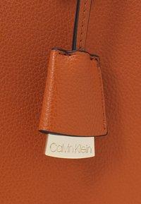 Calvin Klein - TOTE - Handbag - cognac - 4