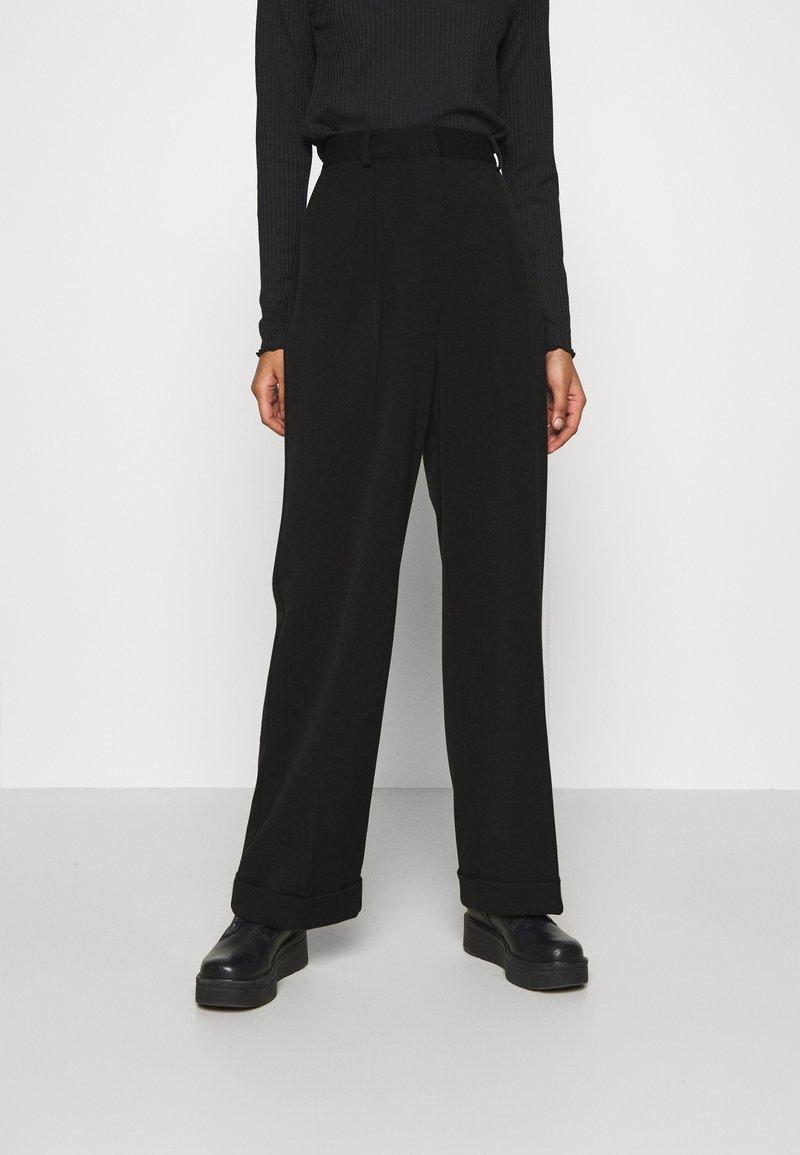 NA-KD - MATHILDE GØHLER SUIT PANTS - Trousers - black