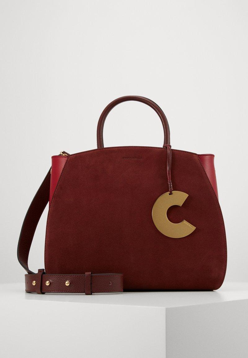 Coccinelle - CONCRETE BICOLOR - Handbag - marsala/cherry