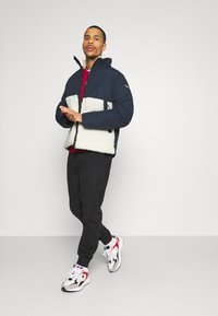 Champion - ROCHESTER HOODED JACKET - Winter jacket - blue - 1