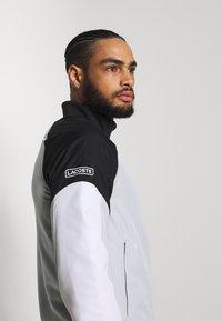 Lacoste Sport - TRACKSUIT - Träningsset - calluna/black/white - 5