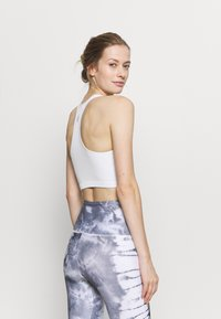 Free People - FREE THROW CROP - Light support sports bra - white - 2