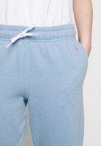 Polo Ralph Lauren - SEASONAL - Spodnie treningowe - chambray blue - 6