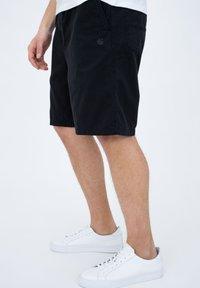 Carhartt WIP - CARSON  - Shorts - black - 3