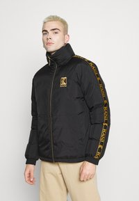Karl Kani - RETRO REVERSIBLE PUFFER JACKET UNISEX  - Light jacket - black - 3