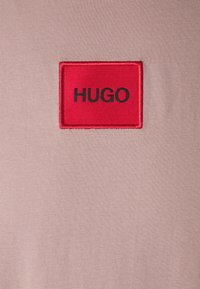 HUGO - DIRAGOLINO - Basic T-shirt - light/pastel brown - 5