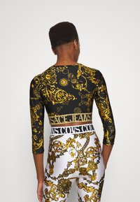 Versace Jeans Couture - Leggings - Trousers - white/gold - 2
