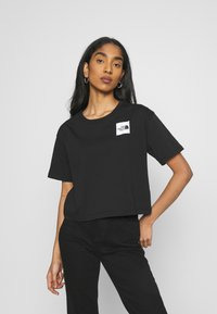 The North Face - CROPPED FINE TEE - T-shirts med print - black - 0