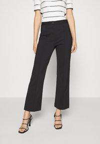 DESIGNERS REMIX - SANSAH FLARED - Trousers - black - 0