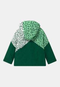 Ziener - ALANI JUN UNISEX - Snowboardová bunda - spruce green/white - 1