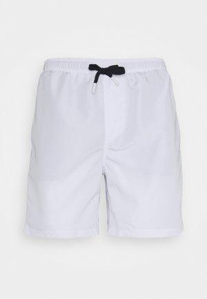 SUNSET BEACH - Swimming shorts - white