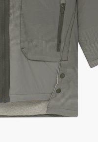 Nike Sportswear - REVERSIBLE - Winter coat - cargo khaki/stone/volt - 4