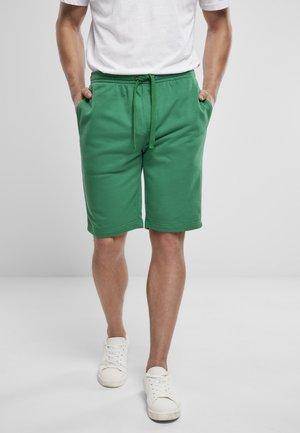 Tracksuit bottoms - junglegreen