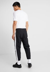 Reebok - MEET YOU THERE TRAINING 7/8 JOGGER PANTS - Tracksuit bottoms - black - 2
