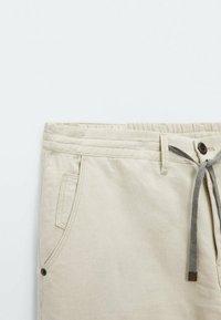 Massimo Dutti - IM VINTAGELOOK  - Trousers - beige - 4