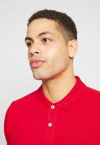 Selected Homme - SLHLUKE SLIM FIT - Polo shirt - true red - 4