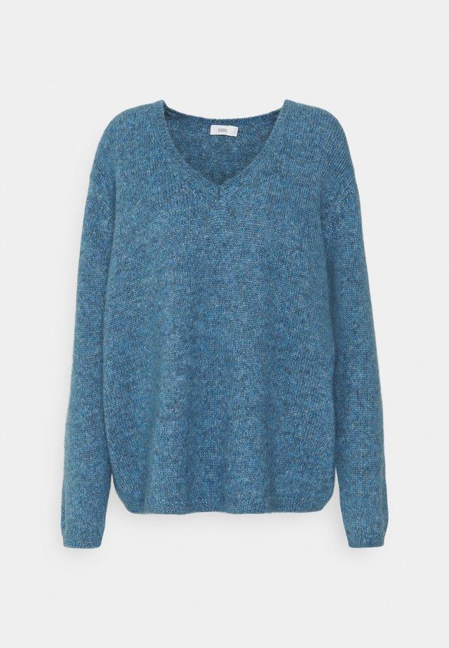 Stickad tröja - commodore blue